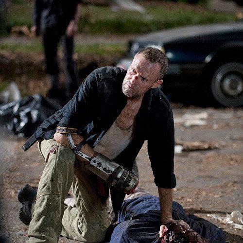 New The Walking Dead Season 3.5 Photos Find Merle Bashing in a Zombie's Head