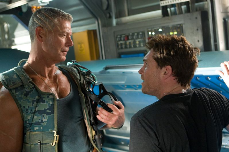 Stephen Lang as Col. Quaritch and Sam Worthington as Jake Sully