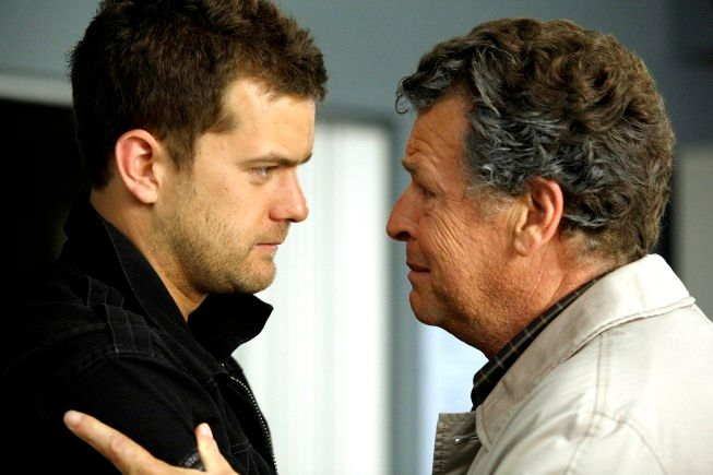 Peter (Joshua Jackson, L) and Walter (John Noble, R) react to a terrible accident