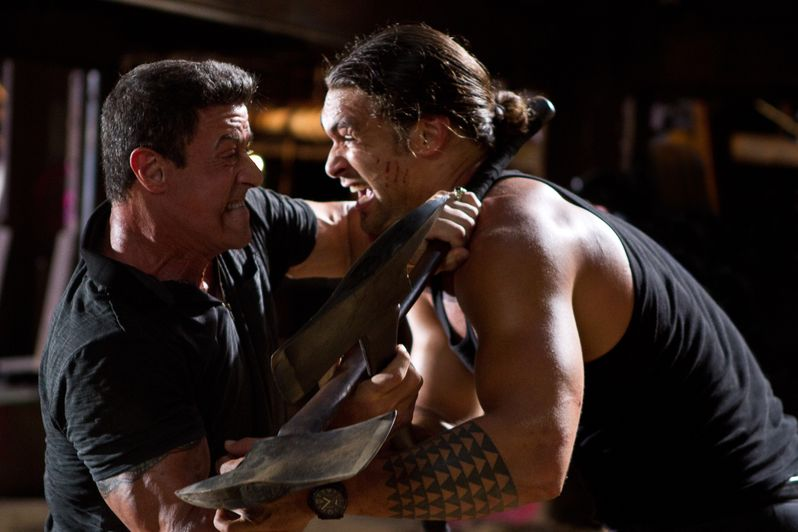 Jason Momoa's Keegan and Sylvester Stallone's Jimmy tangle in an axe battle in <strong><em>Bullet to the Head</em></strong>