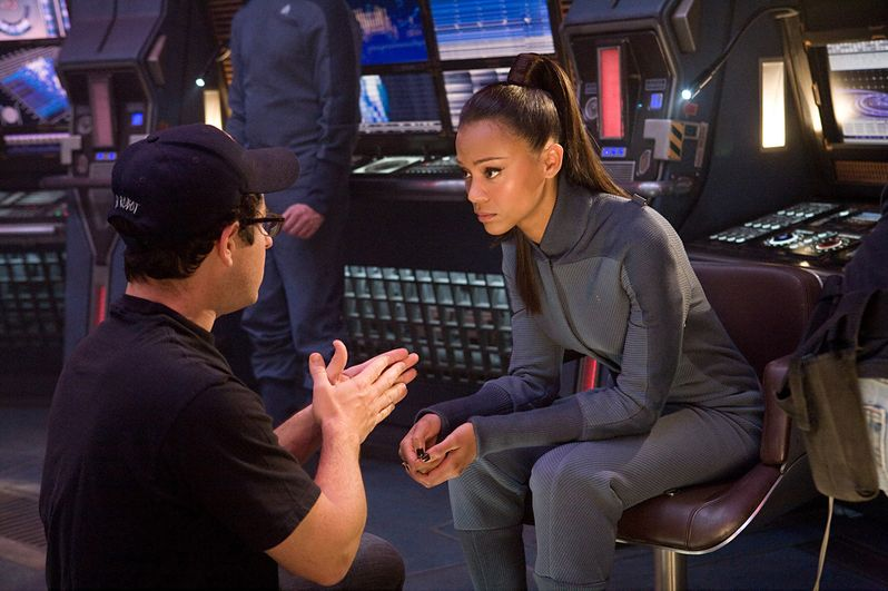 J.J. Abrams explains a scene to Zoe Saldana