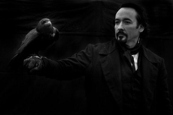 John Cusack in <strong><em>The Raven</em></strong>