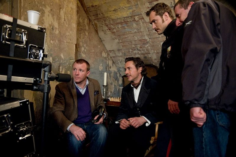 Guy Ritchie, Robert Downey Jr. and Jude Law on the set