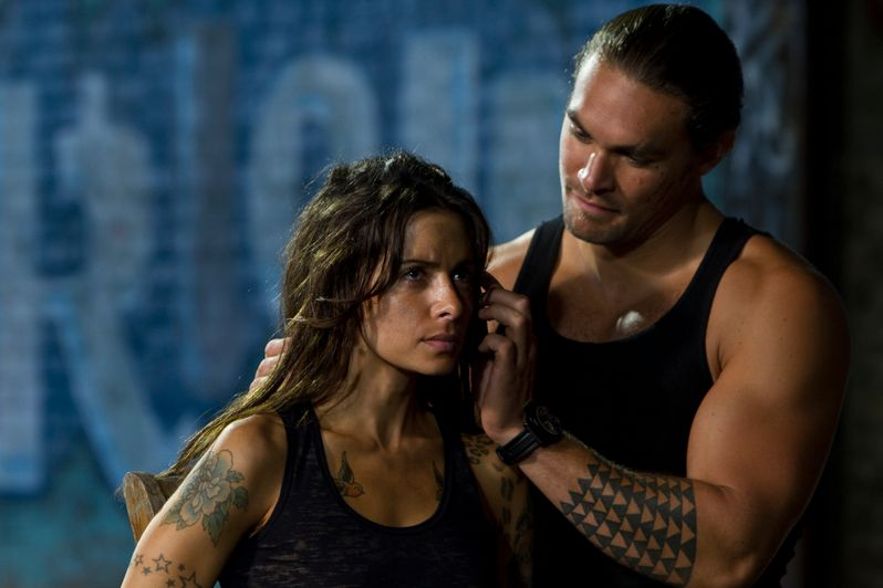 Sarah Shahi and Jason Momoa in a scene from <strong><em>Bullet to the Head</em></strong>