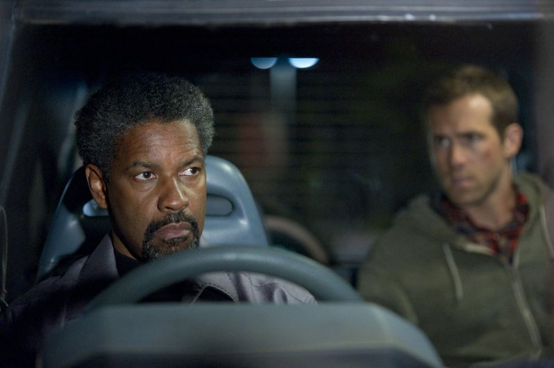 Ryan Reynolds and Denzel Washington in <strong><em>Safe House</em></strong>