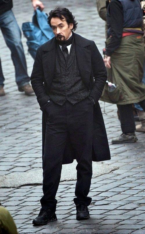 John Cusack as Edgar Allan Poe in <strong><em>The Raven</em></strong>