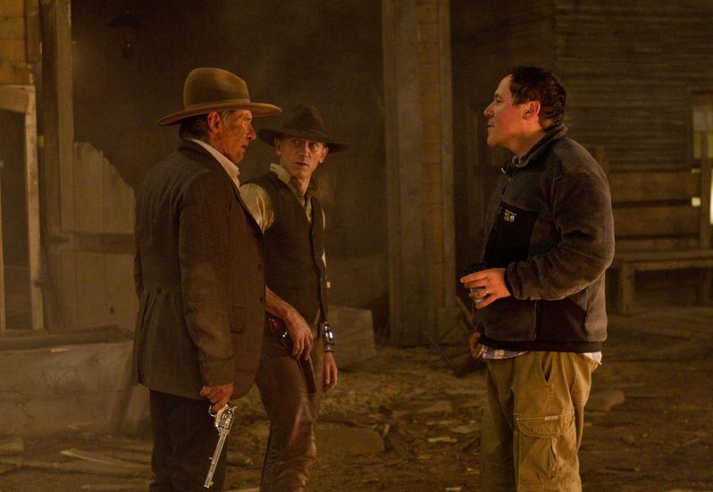 Jon Favreau with Daniel Craig and Harrison Ford on the set