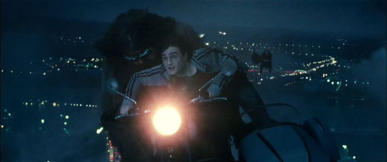 Harry (Daniel Radcliffe) rides with Hagrid (Robbie Coltrane) on his enchanted motorcycle