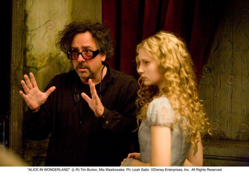 Tim Burton and Mia Wasikowska in <strong><em>Alice in Wonderland</em></strong>