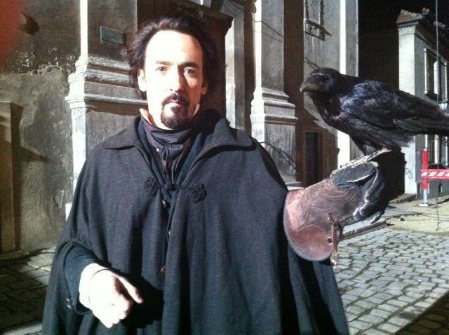 John Cusack on <strong><em>The Raven</em></strong> Set