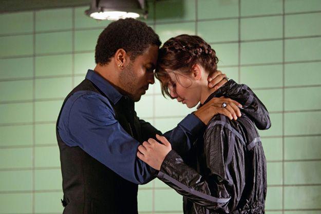 Jennifer Lawrence and Lenny Kravitz in <strong><em>The Hunger Games</em></strong>