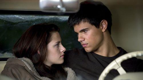 A smitten Jacob (Taylor Lautner) trying to comfort Bella (Kristen Stewart), who mourns Edward's abrupt departure