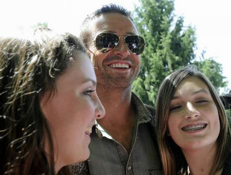 Huge Jackman takes pictures with fans on the set of <strong><em>Real Steel</em></strong>