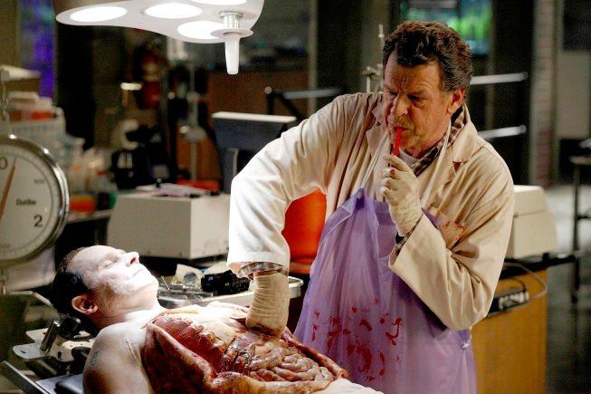 Walter (John Noble) examines a cadaver found at a crime scene