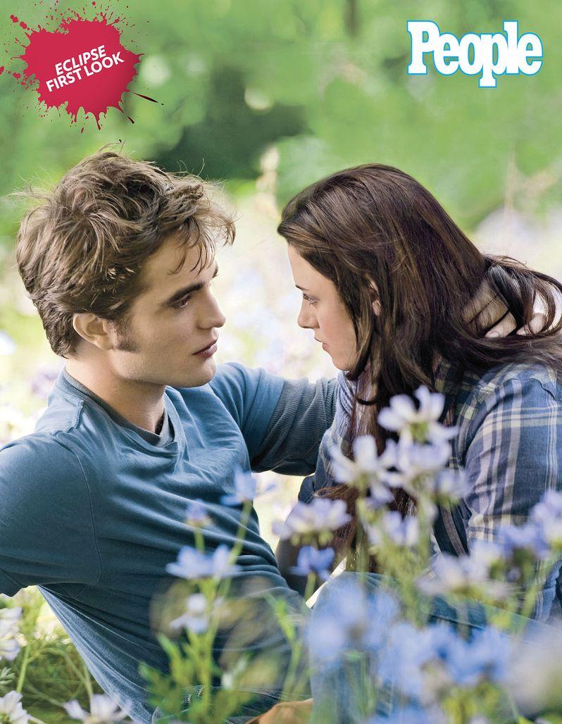 Robert Pattinson as Edward Cullen and Kristen Stewart as Bella Swan