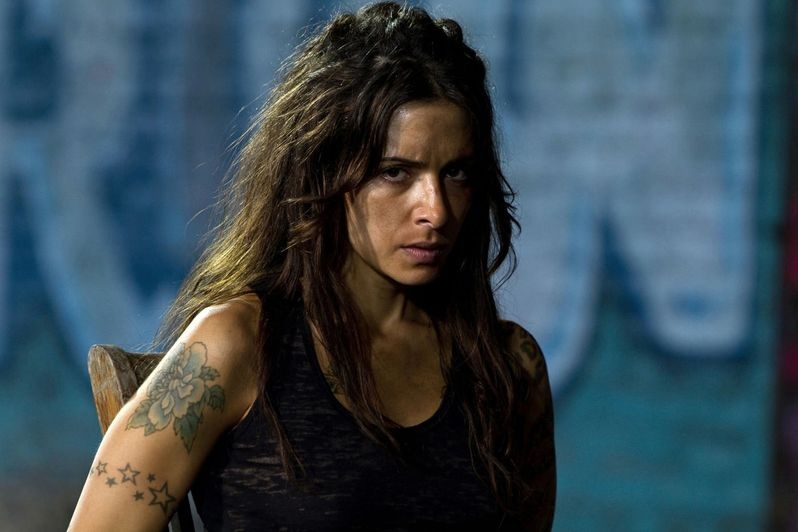 Sarah Shahi stars as Lisa, the daughter of Sylvester Stallone's Jimmy in <strong><em>Bullet to the Head</em></strong>