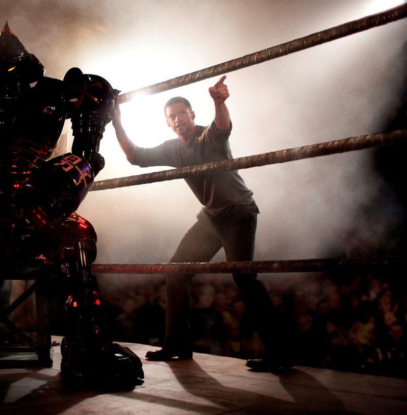 Hugh Jackman instructs a Samurai- design robot